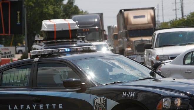 Traffic backs up on Sagamore Parkway near South Street Monday afternoon after a pedestrian was reportedly struck by a car.