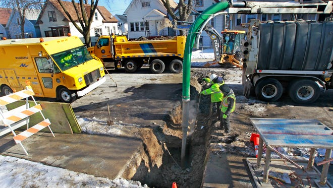 Milwaukee Public Works Department crews repair a break in the city-owned section of a lead service lateral between the water main and a private property boundary in the 2100 block of S. 14th St.