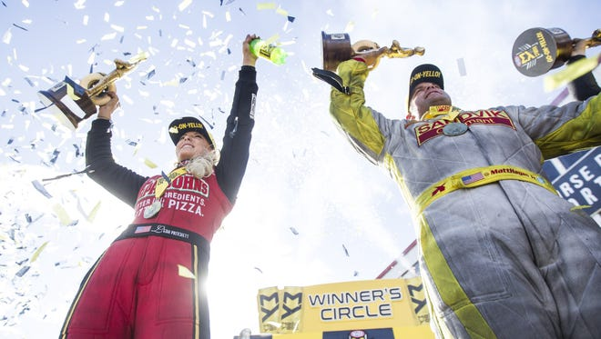 Leah Pritchett (left) and Matt Hagan celebrate in the winners' circle after winning the Top Fuel and Funny Car divisions, respectively, at the National Hot Rod Association races at Wild Horse Pass Motorsports Park in Chandler on Sunday, Feb. 26, 2017.