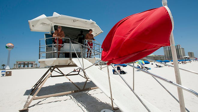 Lifeguard Logan Mead, left, and Aaron Telatovich keep a watchful eye on the surf conditions on Casino Beach Monday afternoon June 25, 2015.
