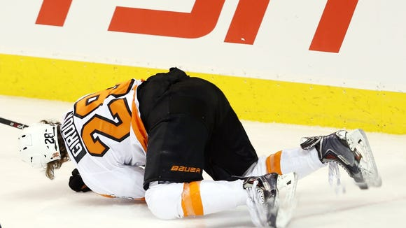 Giroux went down in the third period after getting cut in the left leg.