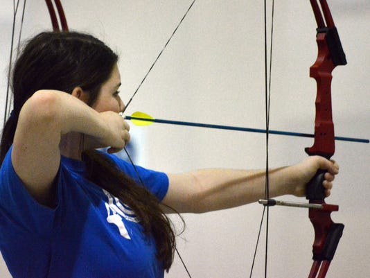 ANI Archery Tournament Cassidy Martin, a student at Sacred Heart School in Moreauville, takes part in the Cenla Shootout south regional tournament at the LSU AgCenter's State Storm Shelter at Louisiana State University of Alexandria Saturday, Jan. 17, 2015