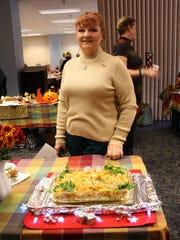 Sharon Sager poses with her Fried Sauerkraut Butterflies