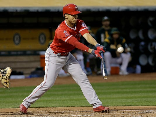 Los Angeles Angels' Andrelton Simmons hits a run-scoring double against the Oakland Athletics during the second inning of a baseball game in Oakland, Calif., Wednesday, April 5, 2017. (AP Photo/Jeff Chiu)
