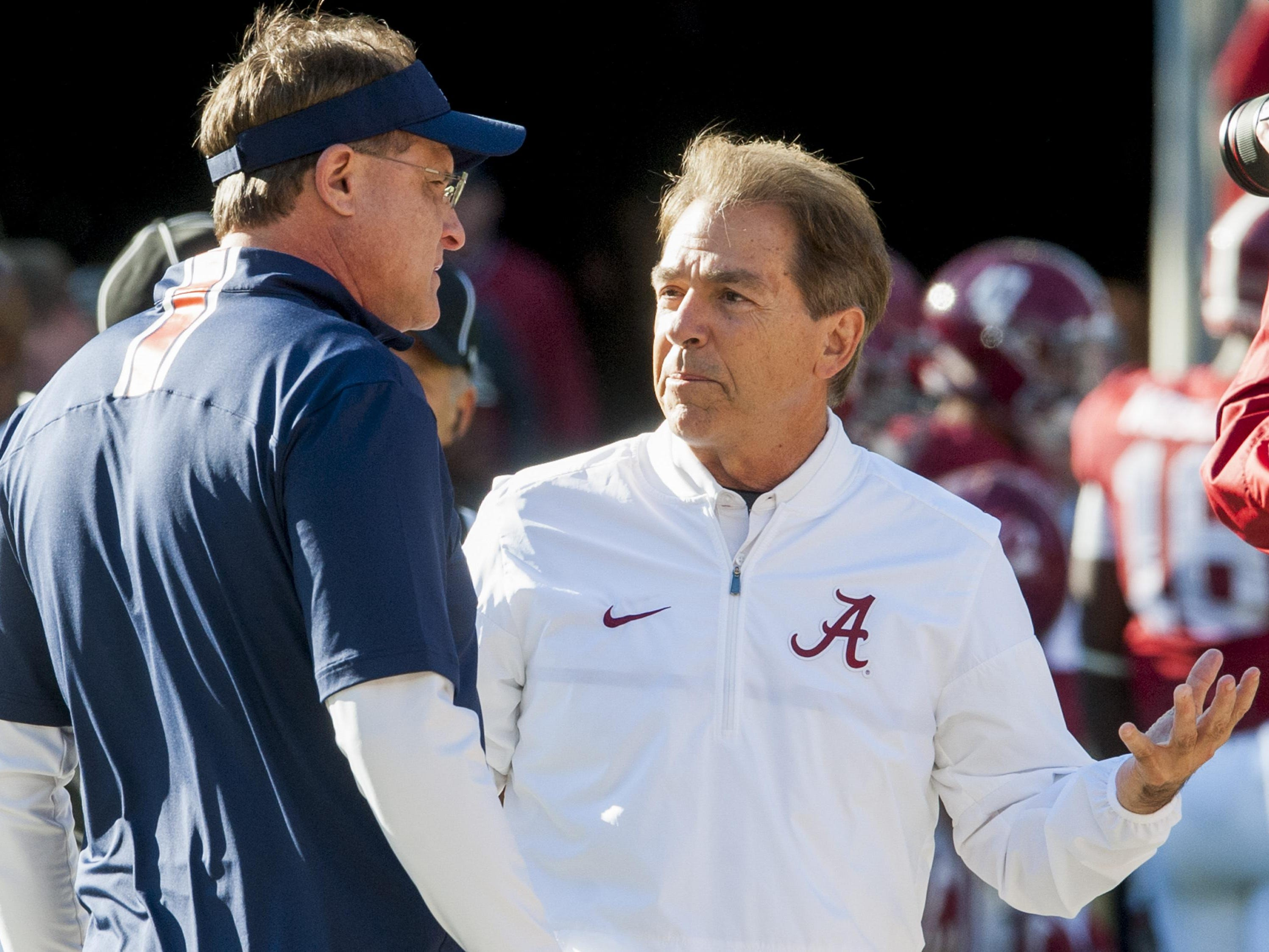 Auburn head coach Gus Malzahn and Alabama head coach Nick Saban chat at midfield before the Iron Bowl at Bryant Denny Stadium in Tuscaloosa, Ala. on Saturday November 26, 2016. (Mickey Welsh / Montgomery Advertiser)