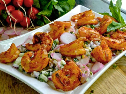 Radish adds a lovely hue in creamy shrimp salad