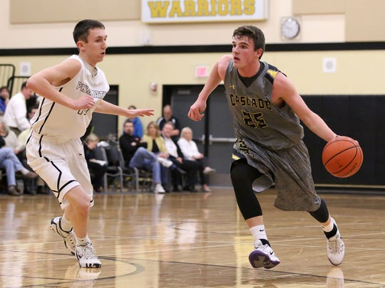 Cascade's Garrett Coffey (25) drives down the court during their game with Philomath on Friday, Feb. 6 , 2015, in Philomath, Ore.