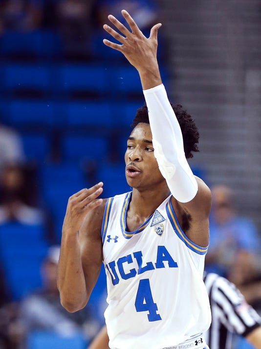 UCLA guard Jaylen Hands signals that he hit a 3-point shot during the second half of an NCAA college basketball game against South Carolina on Friday, Nov. 17, 2017, in Los Angeles. UCLA won 96-68. (AP Photo/Ringo H.W. Chiu)