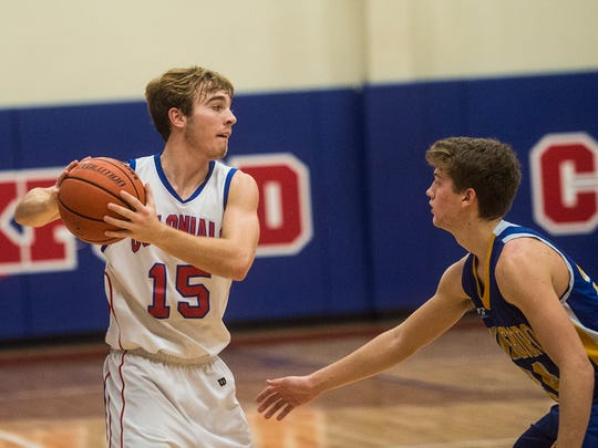 New Oxford's Joey Stiles keeps the ball away from Waynesboro on Dec. 30, 2015 during the Colonial Holiday Tournament at New Oxford High School.