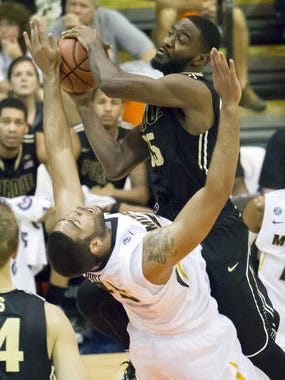 Rapheal Davis' career-best 22 points and lockdown defense led Purdue to an 82-61 victory over Missouri.
