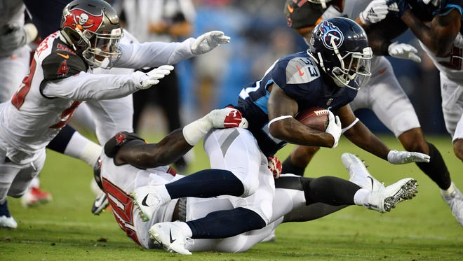 Titans running back Dion Lewis (33) gains yards in the first half of a preseason game against the Buccaneers at Nissan Stadium Saturday, Aug. 18, 2018, in Nashville, Tenn.