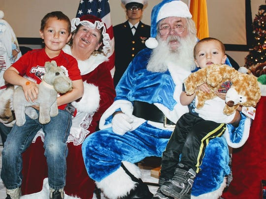 Two young siblings visited Santa Claus and Mrs. Claus after they received toys from the Otero County Toys for Tots program at the Sgt. Willie Estrada Civic Center Friday, Dec. 23.