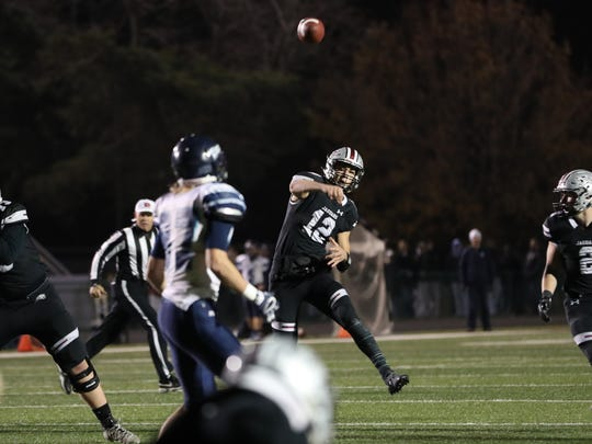 Ankeny Centennial QB Chance Gibbons throws a pass against