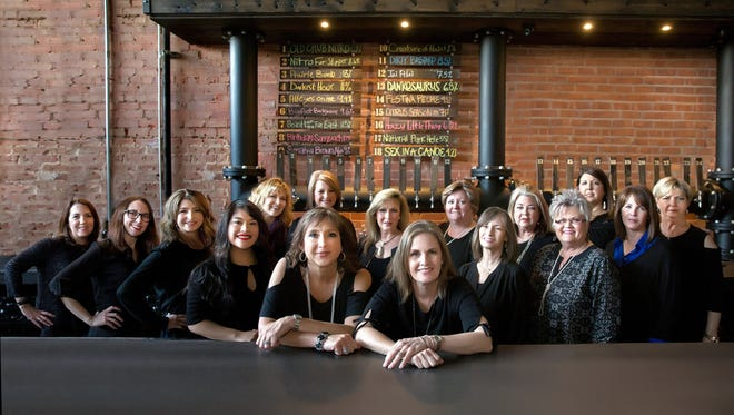 The steering committee for the 2018 Red River Wine and Beer Festival, held March 24, included: (front, center) Chairs Liz Wathen and Lesa Reimers; (back from left to right): Teressa Stephenson, Michelle Prouty, Karol Gilbert, Marianne Dowdy, Tamara Barfield, Jadine Buckley, Annette Ritchie, SJF President Mary Brasher, Lori Wood, Sharon Norton, Roma Martin, Susan Phillips, Vicki McCarty, and Delores Culley.