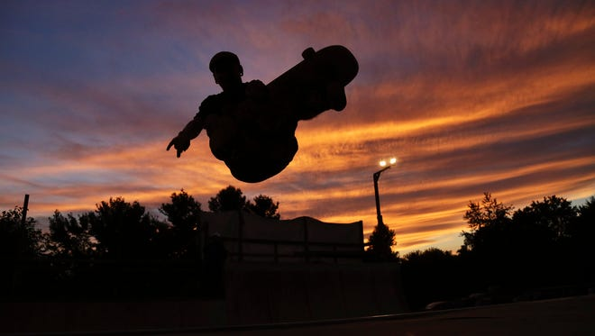 The sun sets as skateboarding continues at Farm Party.
