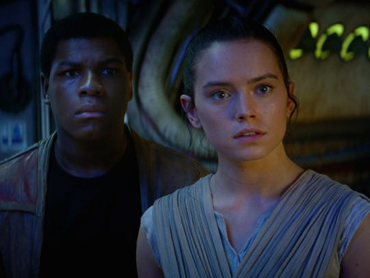 Finn (John Boyega, left) and Rey (Daisy Ridley) in 'Star Wars: The Force Awakens.'