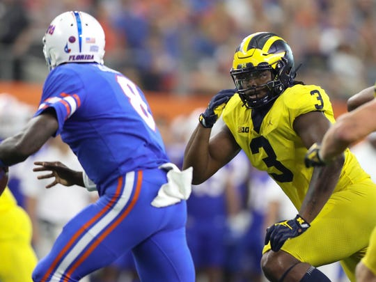 Michigan's Rashan Gary pressures Florida's Malik Zaire