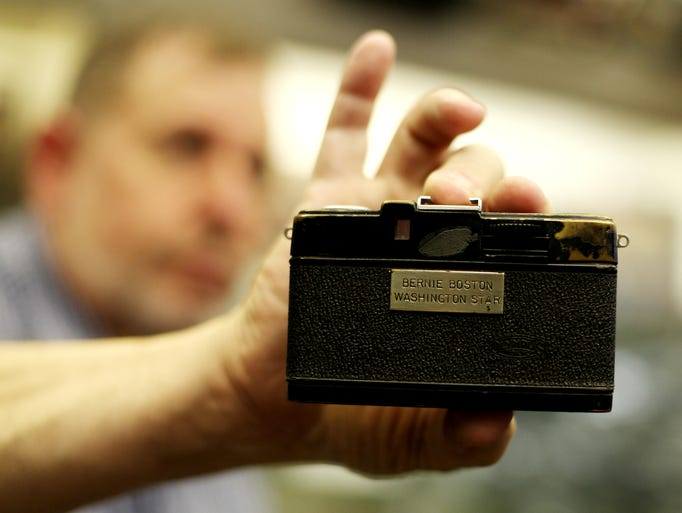 David Schwartz holds an Olympus Pen W, one of the cameras of Pulitzer Prize-winning photographer Bernie Boston who worked for the Washington Star and the Washington bureau of the Los Angles Times at the Camera Heritage Museum in Staunton on August 15, 2014. Boston covered the assassination attempt on President Ronald Reagan in 1981 with this camera, which he always carried in his pocket as an emergency back-up.