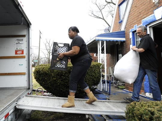 LaTasha Tucker of Detroit gets help from family to move out after she was evicted from her rental in 2017 on Detroit's northwest side, even though her landlord ignored her pleas for help to fix her basement sewage backups.