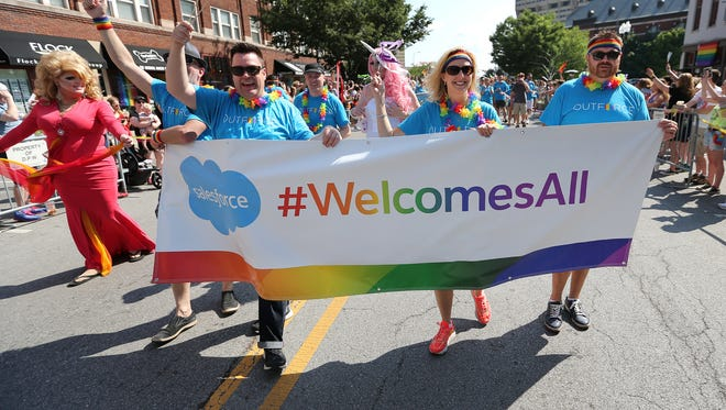 Salesforce employees waved to the crowd during the Cadillac Barbie IN Pride Parade in Downtown Indianapolis in June 2015.