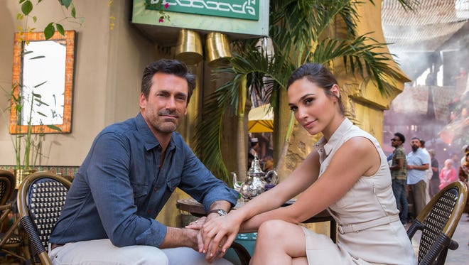 """Jon Hamm and Gal Gadot play covert operatives posing as a suburban couple in """"Keeping Up with the Joneses."""""""