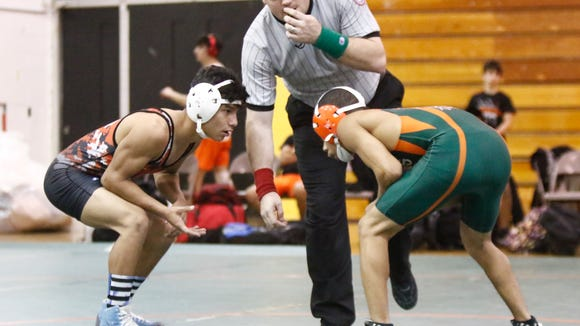 East Ramapo defeats Mamaroneck 54-22 in the opening round of the Section 1 Dual Meet Championships at East Ramapo High School in Spring Valley on Wednesday, December 7, 2016.