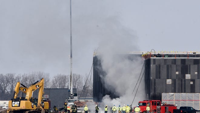 Firefighters respond to a fire at the new Sartell High School construction site Thursday, March 22, in Sartell.