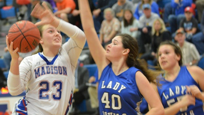 Madison senior Lexi Ammons (23) has committed to play college basketball for Lees-McRae.