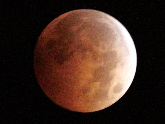 "The ""blood moon, created by the full moon passing into"