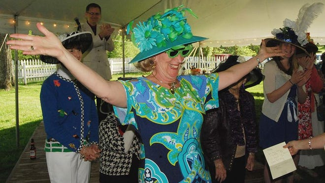 Chris Sturgil of Florence won the best Derby hat contest during the 2014 Dinsmore Homestead Kentucky Derby Party. At this year's event on May 7, there will be a hat and costume contest. The costume theme is celebrities.
