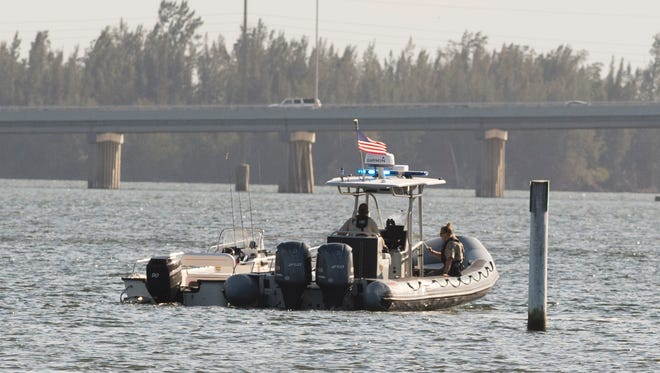 Rescue personnel search for missing teen Jimmy Graves on Dec. 4, 2016, after he fell into the Indian River Lagoon south of the Alma Lee Loy Bridge in Vero Beach. The teen's body was later found in the area where he was knocked into the water.