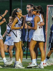 Senior Callie Sundin (10) is congratulated on her goal during the Morris County Tournament Girls Lacrosse Championship between Morristown and Mountain Lakes in Montville, May 5, 2018.