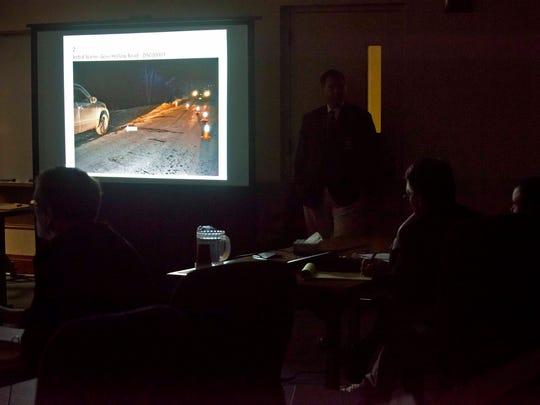 Allen Prue, right, watches evidence photos presented