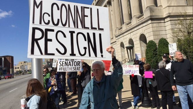 Protestors call for Kentucky Sen. and Senate Majority Leader Mitch McConnell's resignation outside the Federal building on Braodway.