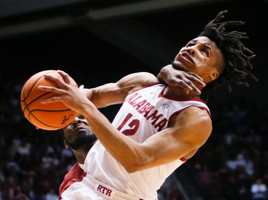 Alabama guard Dazon Ingram (12) is fouled by Arkansas forward Arlando Cook during the first half of an NCAA college basketball game in Tuscaloosa, Ala., Saturday, Feb. 24, 2018. A technical foul was called on Cook. (Erin Nelson/The Tuscaloosa News via AP)