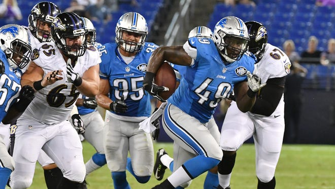 Lions linebacker Khaseem Greene recovers a Ravens fumble on Saturday night.