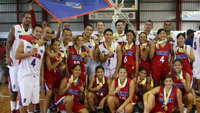 In this file photo, the Guam men's and women's basketball teams proudly display their gold medals at the 7th Micronesian Games in Koror, Palau.