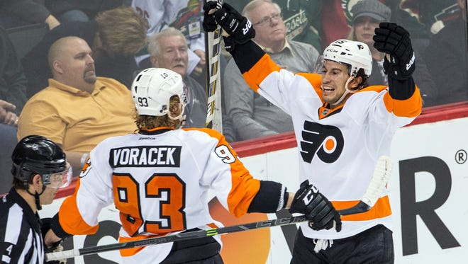 Michael Del Zotto, right, had his second career two-goal game in the Flyers' 4-3 overtime win.