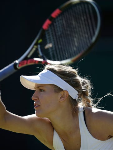 Eugenie Bouchard of Canada returns a ball to Ying-Ying