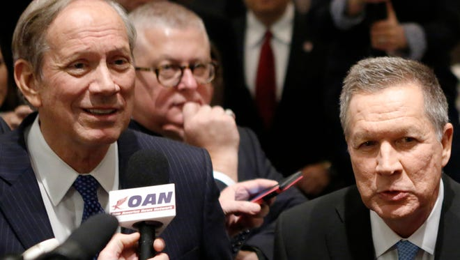 Former New York governor George Pataki and John Kasich speak to members of the media during the New York Republican State Committee Annual Gala on April 14, 2016.