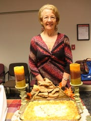 Martha Dulin poses with her Holiday Potatoes side dish