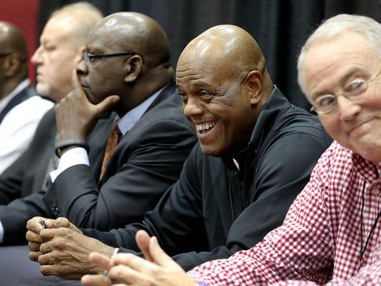 Tom Abernethy, right, Scott May,smiling, Quinn Buckner,
