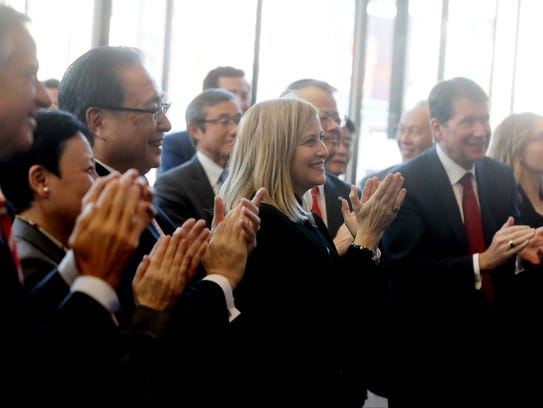 Mayor Megan Barry applauds the announcement that Bridgestone will extend the naming rights agreement by five years for Bridgestone Arena during an event Wednesday at the Bridgestone Tower.