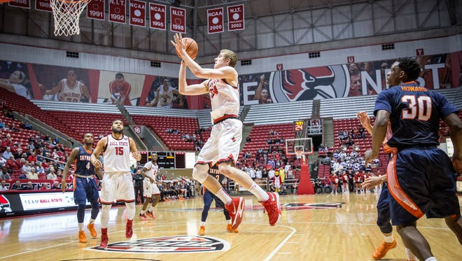 Sean Sellers flys through the air during a layup for Ball State and the first basket during overtime. UT Martin led most of the second half Ball State winning in overtime with a final score of 83-80.