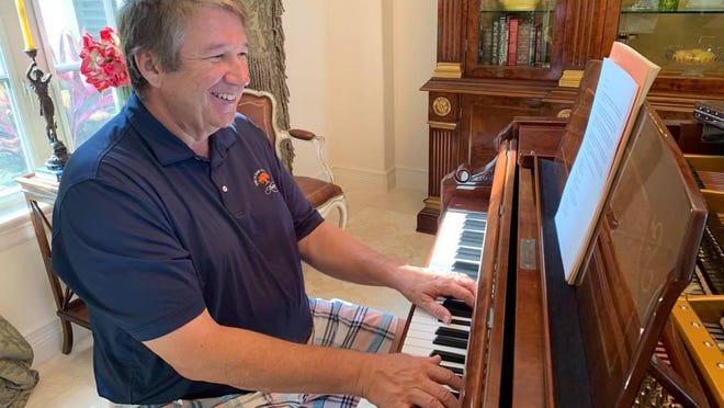 Stephen Hendrickson sits at the piano at his Jupiter Inlet Colony home.