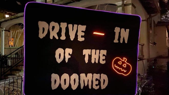 Scott Kirsner's handmade sign for his Halloween-themed driveway movie theater.