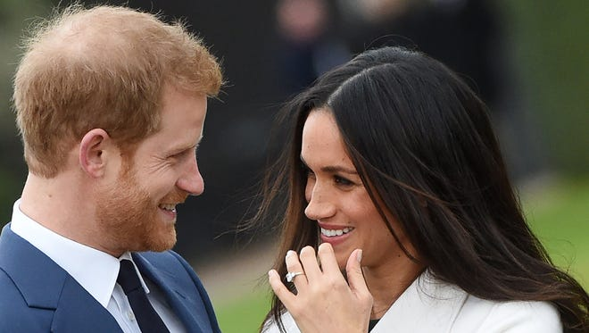 Meghan and Harry met the press after announcing their engagement on Nov. 27.