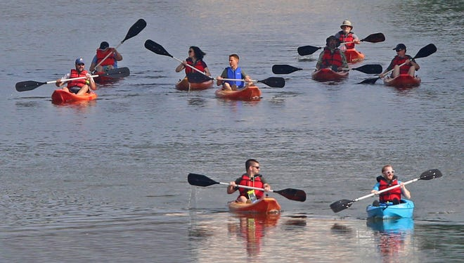 People canoe down White River for Canoe to Work Day, Friday, June 1, 2018.  Mayor Joe Hogsett joined others canoeing and kayaking down the Indianapolis waterways to downtown.  CBBEL (Christopher B. Burke Engineering, LLC) and Citizens Energy Group sponsored the event to celebrate the Indiana waterways, and the mayor officially proclaimed June 1 as Canoe to Work Day in Indianapolis.