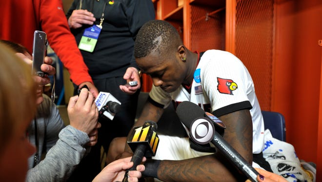 U of L's Terry Rozier sat dejected in the locker room and answered questions from reporters.  March 29, 2015.
