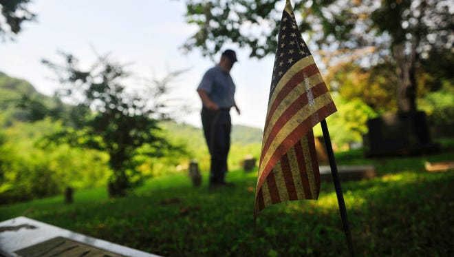 Jim DeMoss talks about his brother, Harold DeMoss, in the family cemetery.